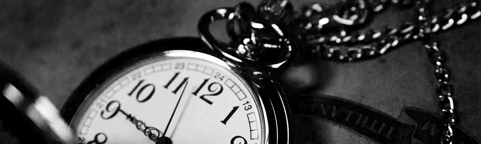 Close-up of the face of an antique pocket watch.