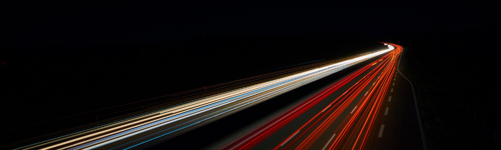 Long-exposure photo of automobile headlights and taillights at speed
