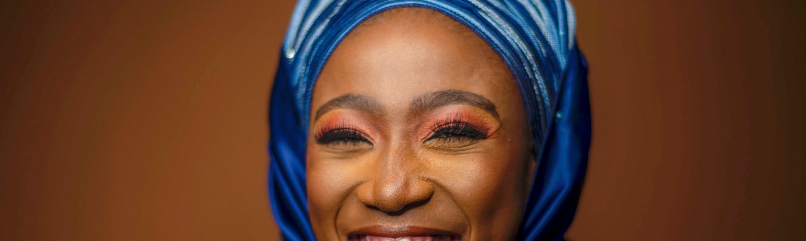 woman in blue hijab smiling