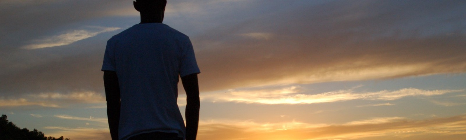 Man standing alone in sunset