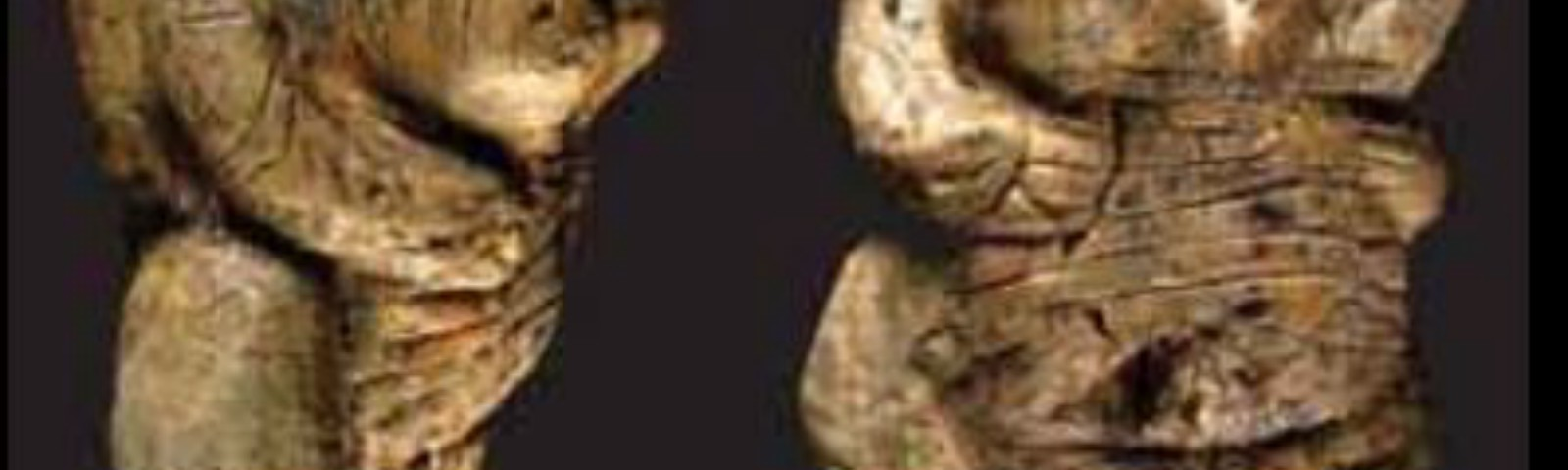 Figurine known as Venus of Hohle Fels with large breasts and exaggerated anatomy.