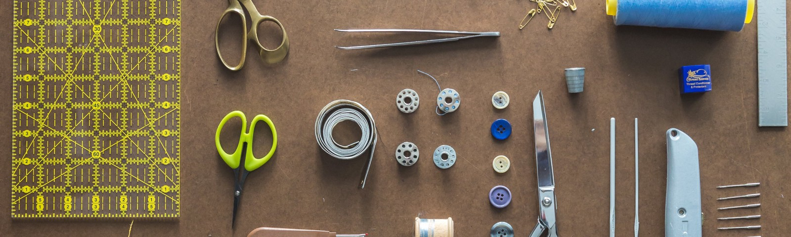 Sewing tools laid out on a table.