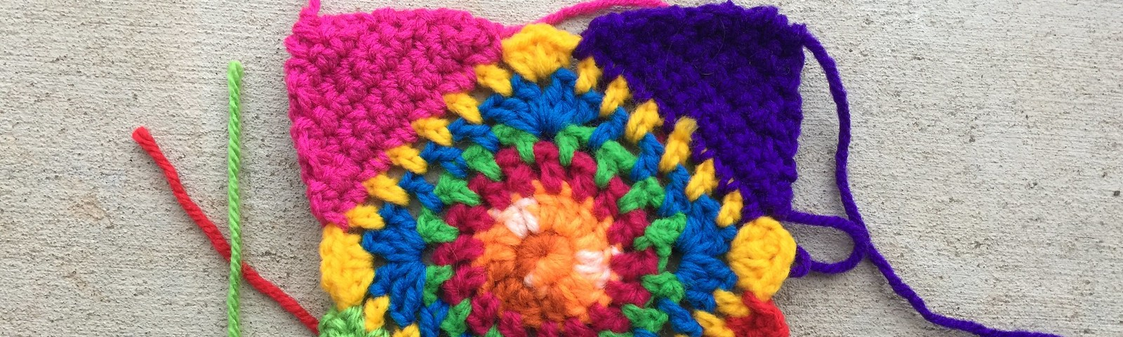 A multicolor crochet granny square for difficult times