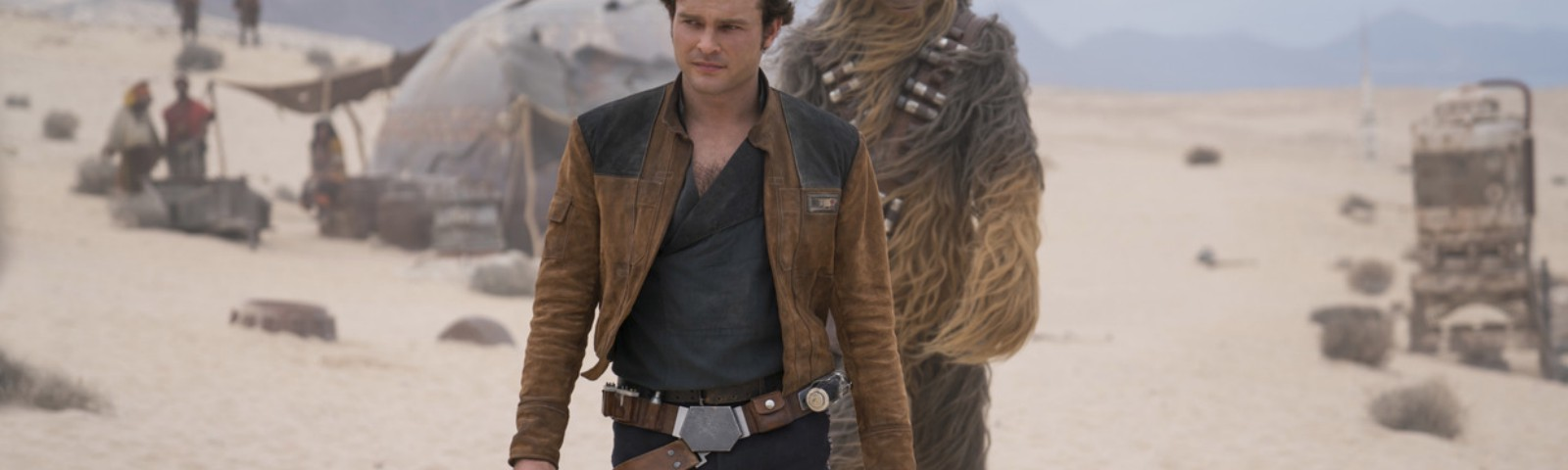 A scene from 'Solo: A Star Wars Story,' featuring a young Han Solo and Chewbacca