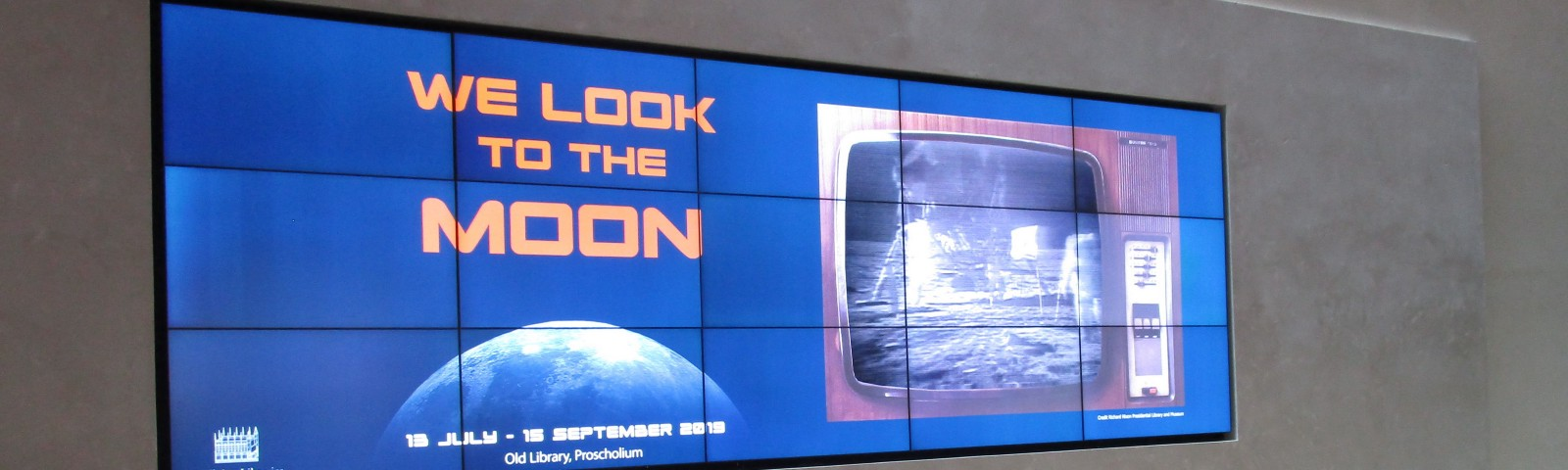 Heritage screen in Blackwell Hall, Bodleian Library, with Moon landing footage playing