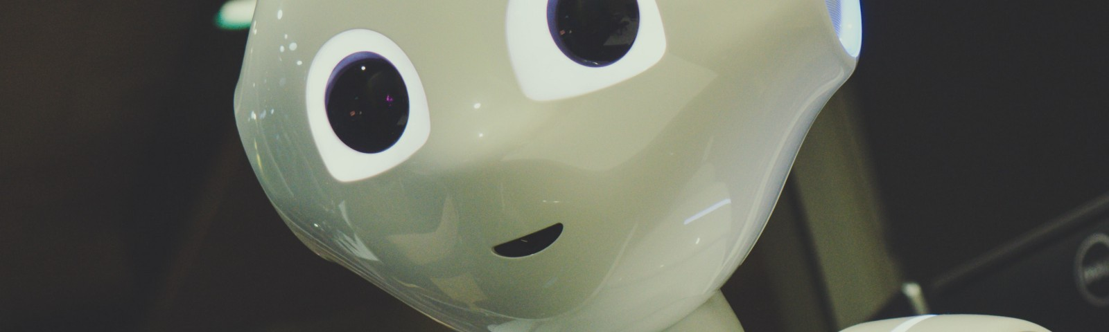 Robot with human features, smiling