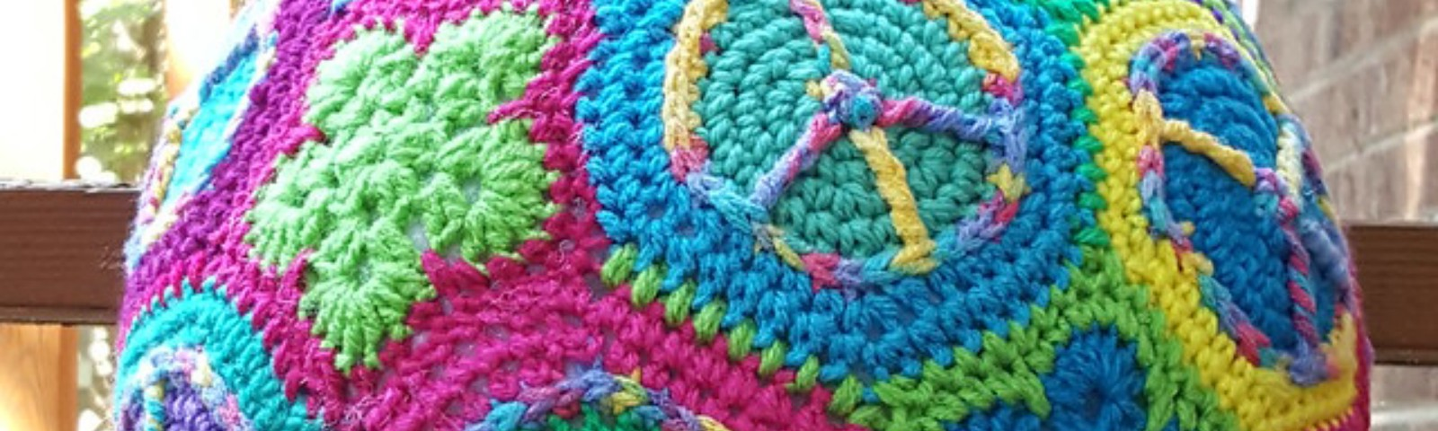 A peace sign crochet soccer ball, the pieces of which were joined with the help of a standing single crochet stitch