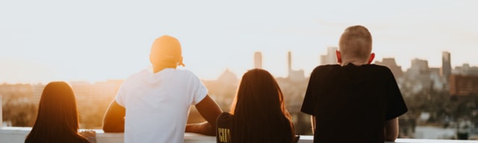 Four teenagers looking out at the city