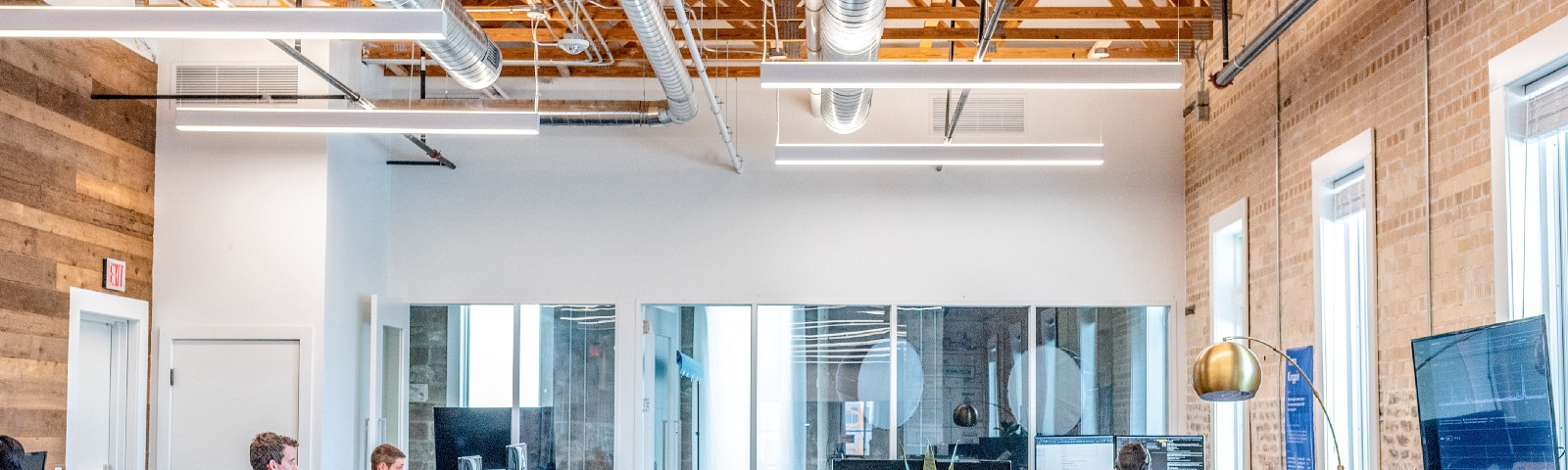 Bright, open office space with some people working at their desks