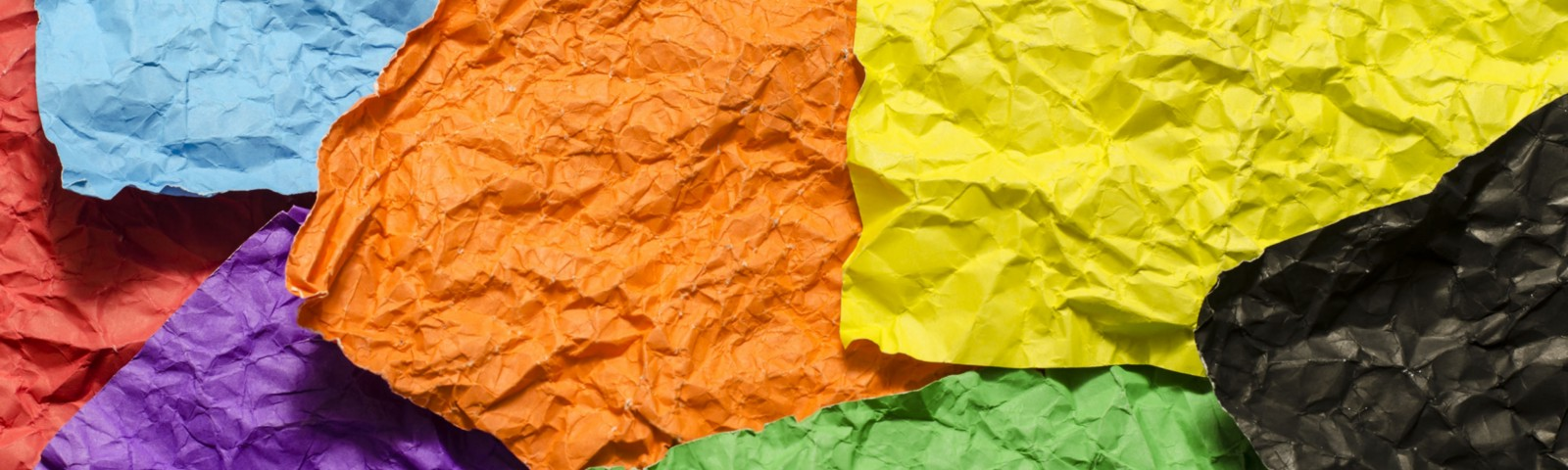 6 crumpled, blank post-it notes in different colours