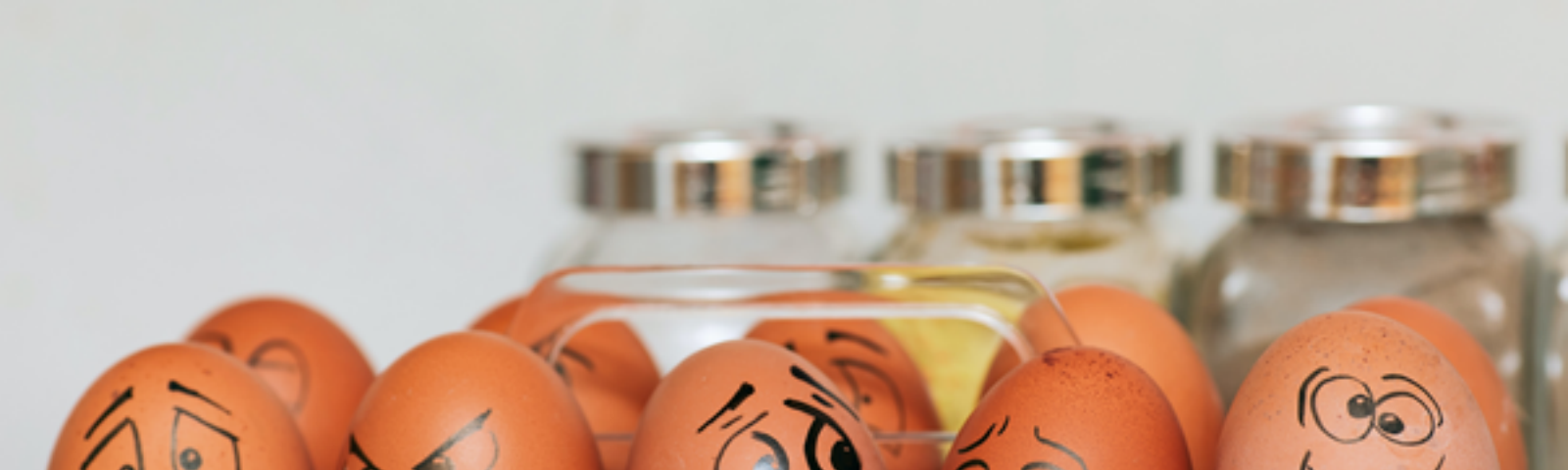Box of eggs with happy/sad/mad faces.
