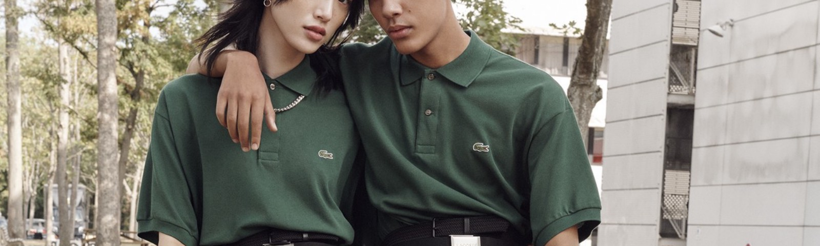Two models pose for Lacoste's unisex campaign.