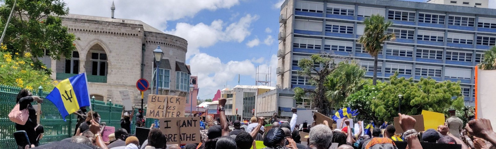 Black Lives Matter protest in Bridgetown, Barbados (photo by Sharon Hurley Hall) — shows people kneeling near to the Parliament building