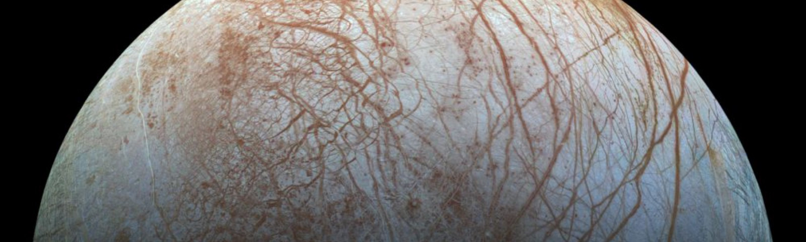 The oceans of Europa create intricate series of lines across the surface of this mighty moon.