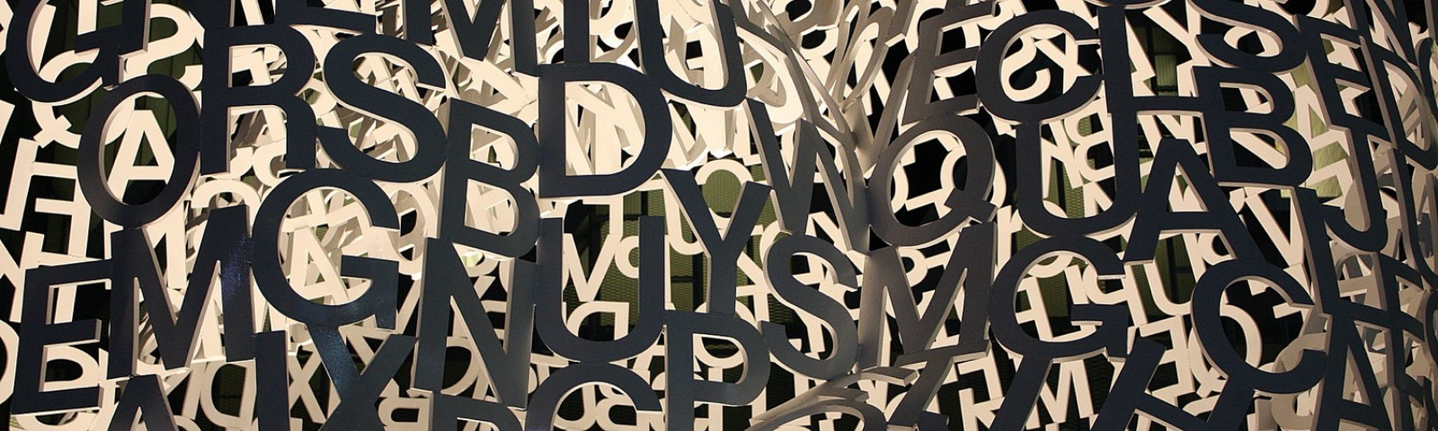 A jumble of cutout letters.