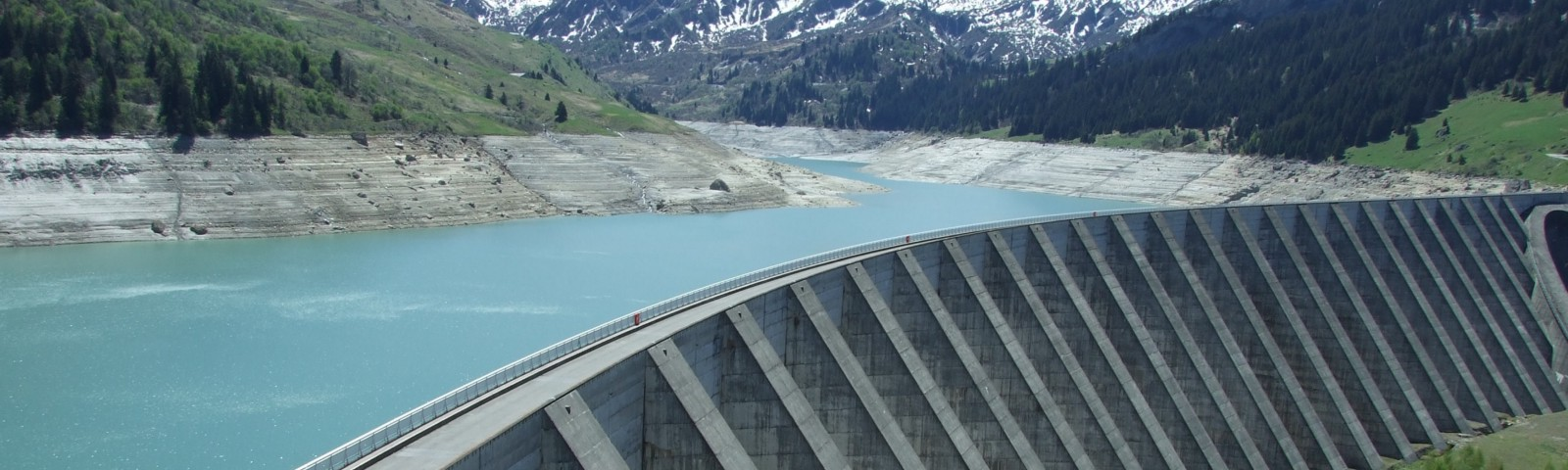 A dam with mountains in the background