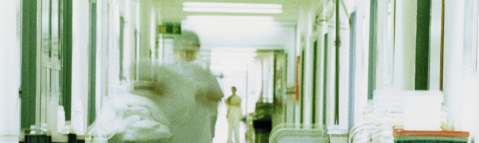 A blurry image of a hospital hallway.