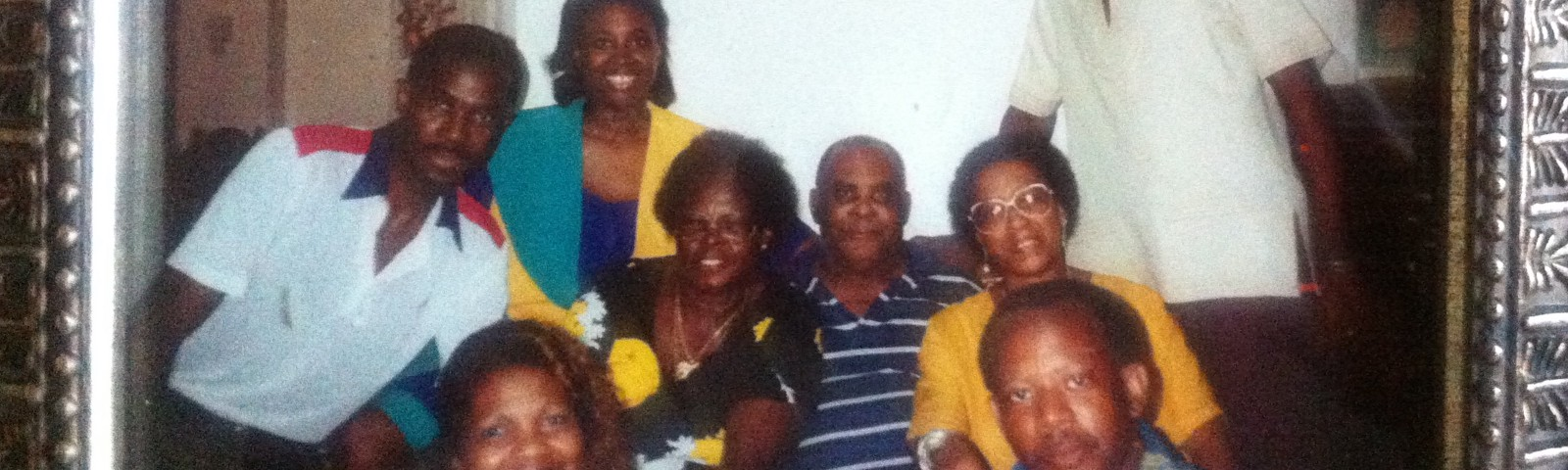 A photo of two generations of a Black family.