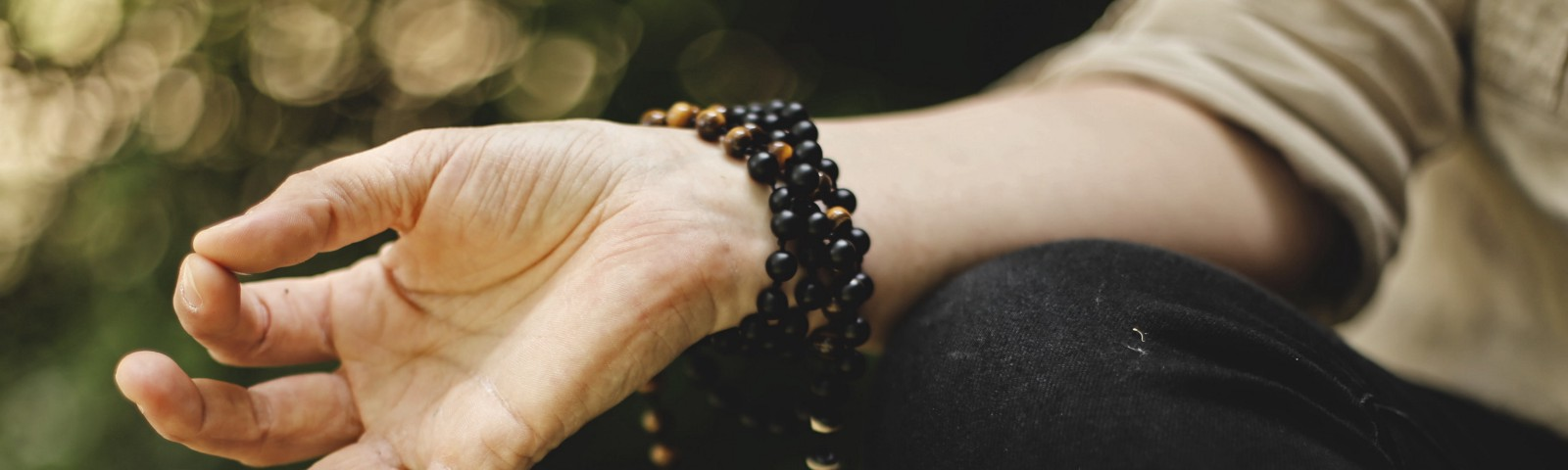 A closeup photo of the hand of someone meditating.