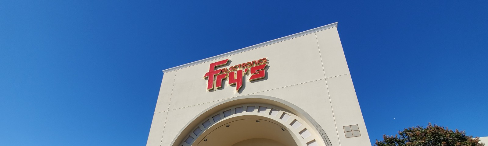 Photo of a Fry's Electronics store entrance from outside.