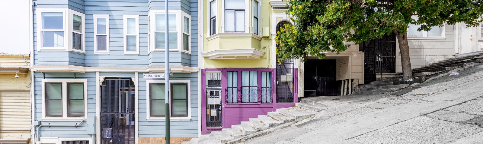 Historic colorful buildings along one of San Francisco's steepest streets near the Telegraph Hill residential area.