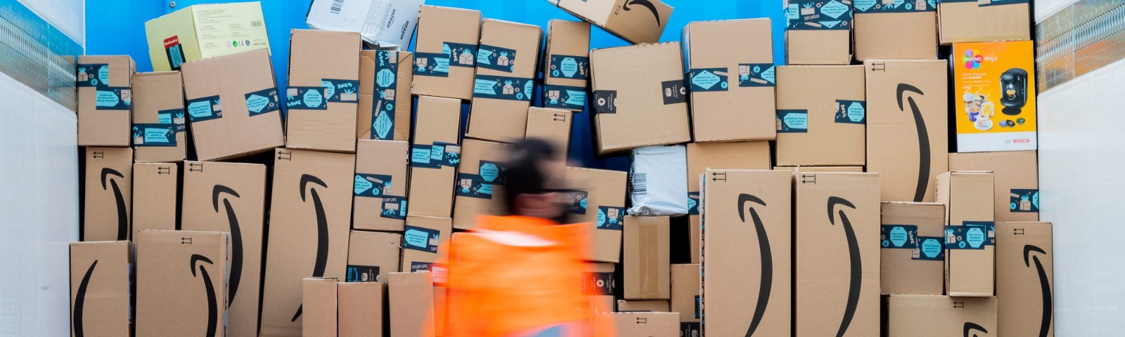 An Amazon worker among packages.