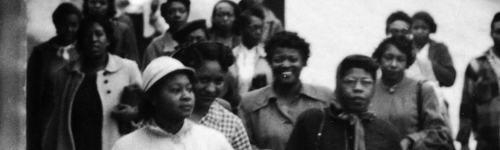 An archival photo of African American women walking to work/go shopping during the Montgomery Bus Boycott.