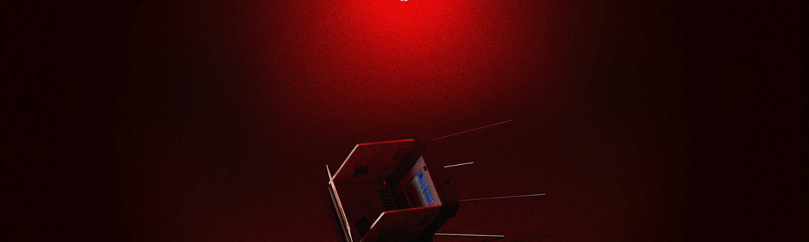 An overturned voting booth beneath a red lightbulb in a dark space.