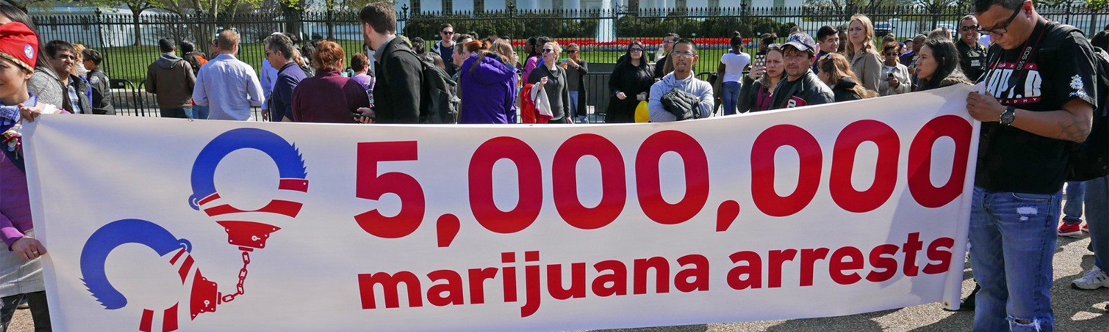 """A group in front of the White House, holding a banner that says """"5 million marijuana arrests"""""""