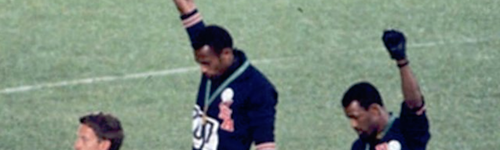 Tommie Smith and John Carlos give the Black Power salute in 1968. Peter Norman at left.