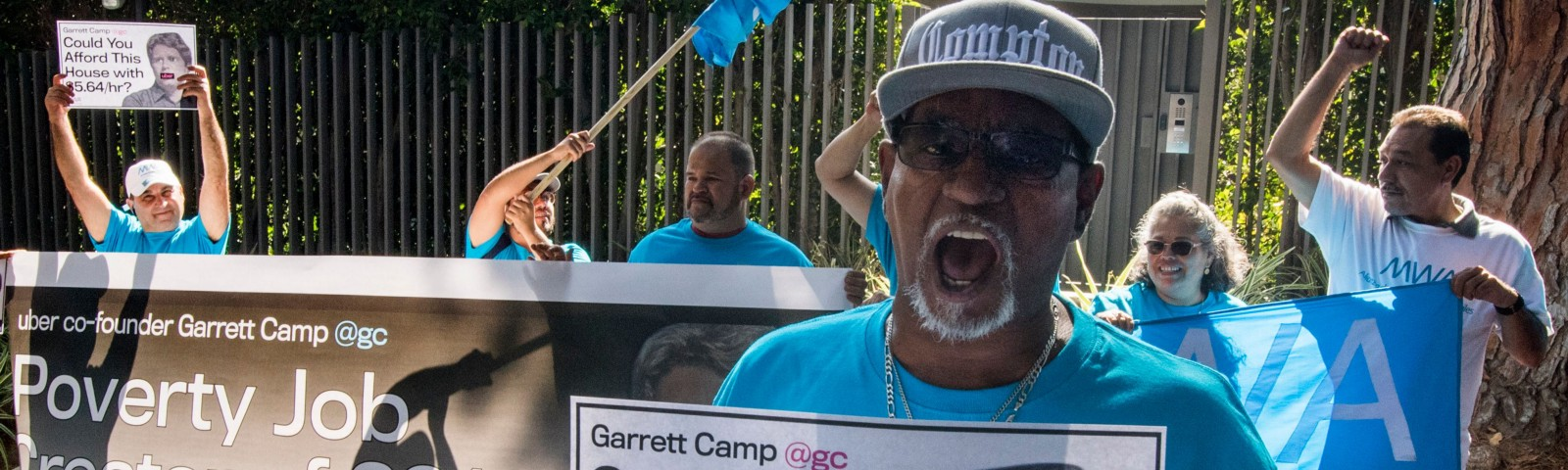 Uber and Lyft drivers demonstrate outside the $72 million home of Uber co-founder Garrett Camp to protest unfair wages.