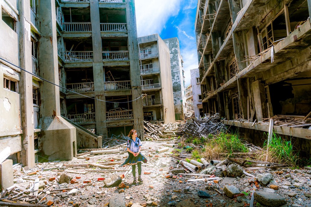 A girl alone in a destroyed city.