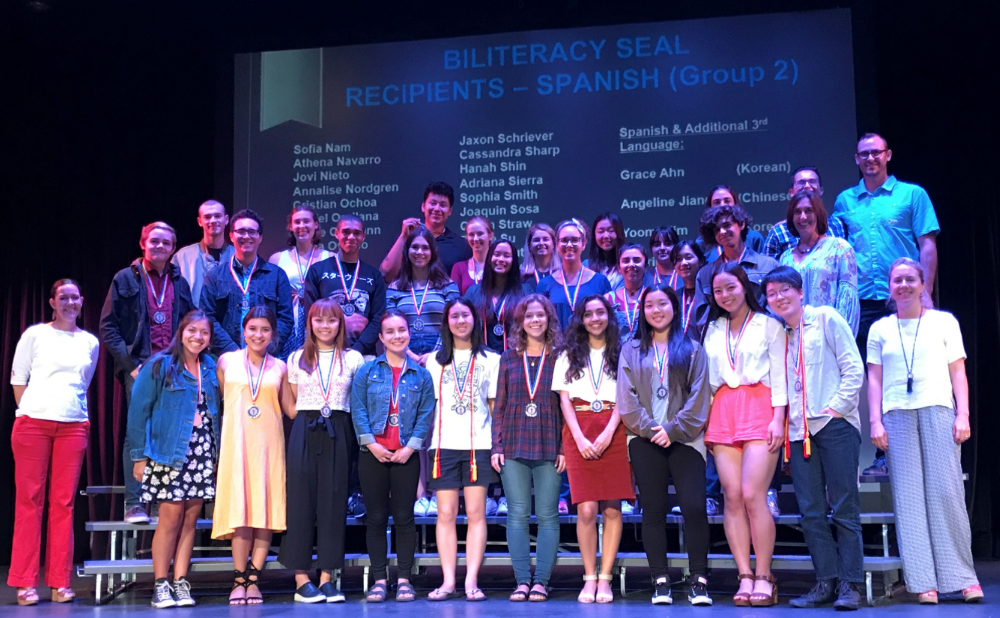 Group of Biliteracy Seal Recipients wearing medals