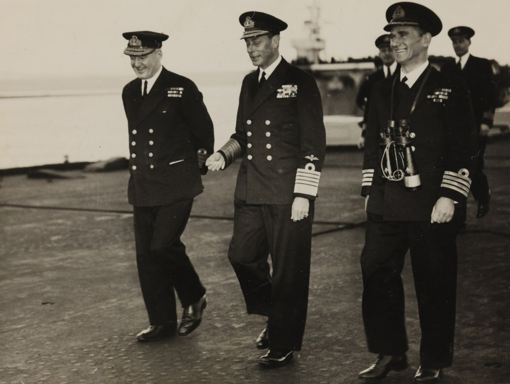 Three high ranking soldiers walking and smiling.