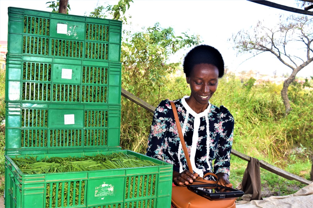 Antoinette Umurerwa with crates of green beans
