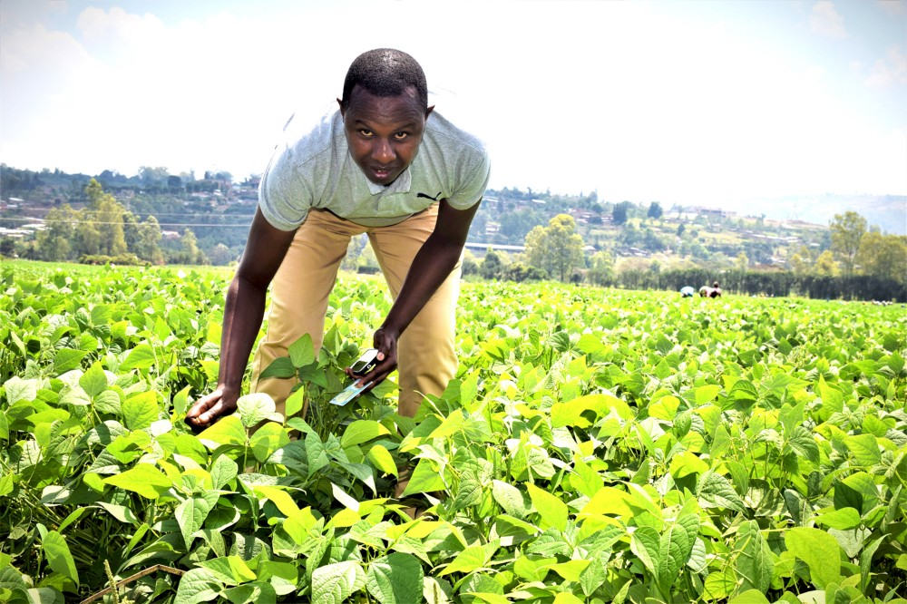 James Sekayange in a field