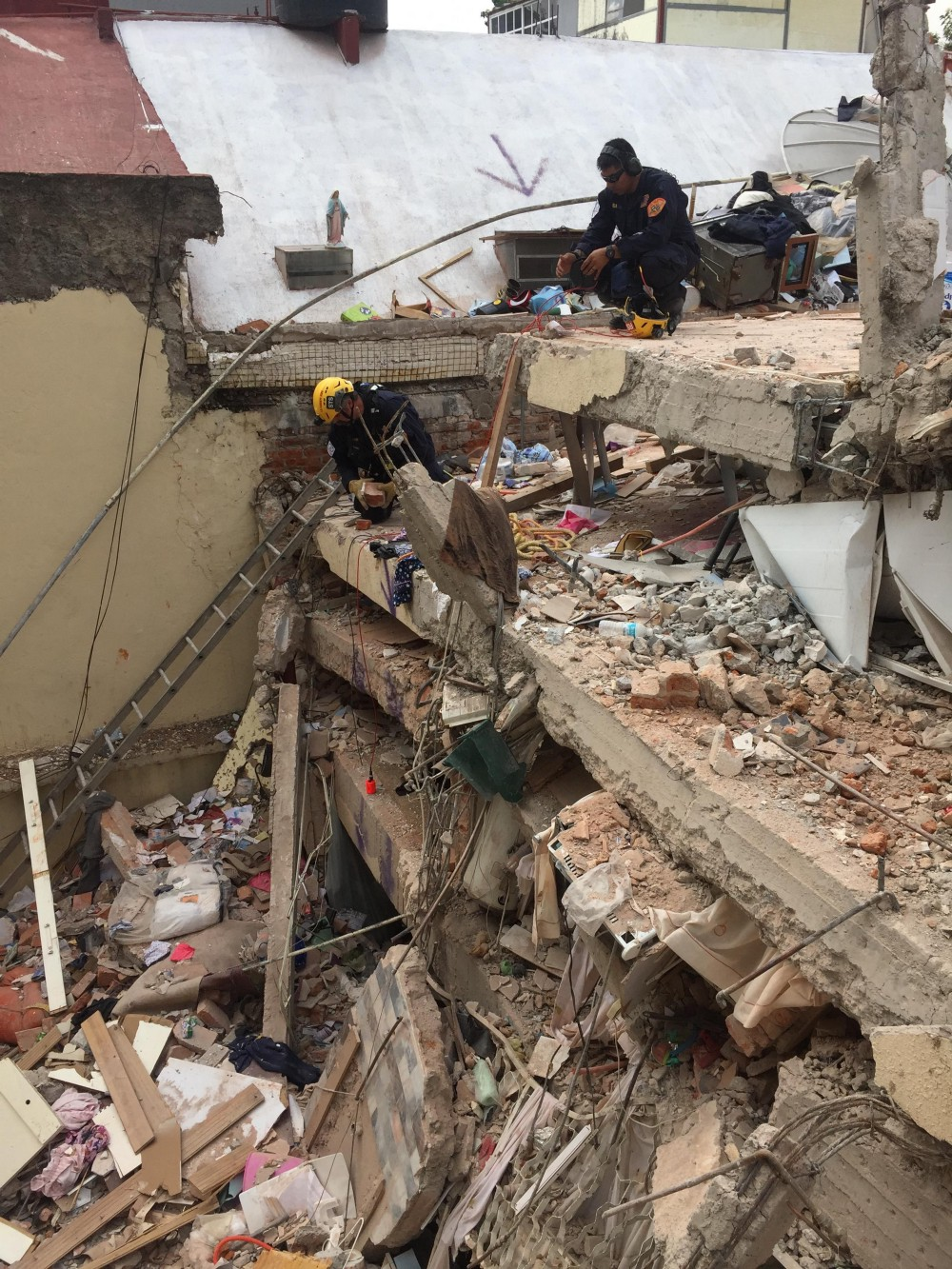 This highly trained crew used rescue dogs, listening devices and search cameras to search through the rubble.