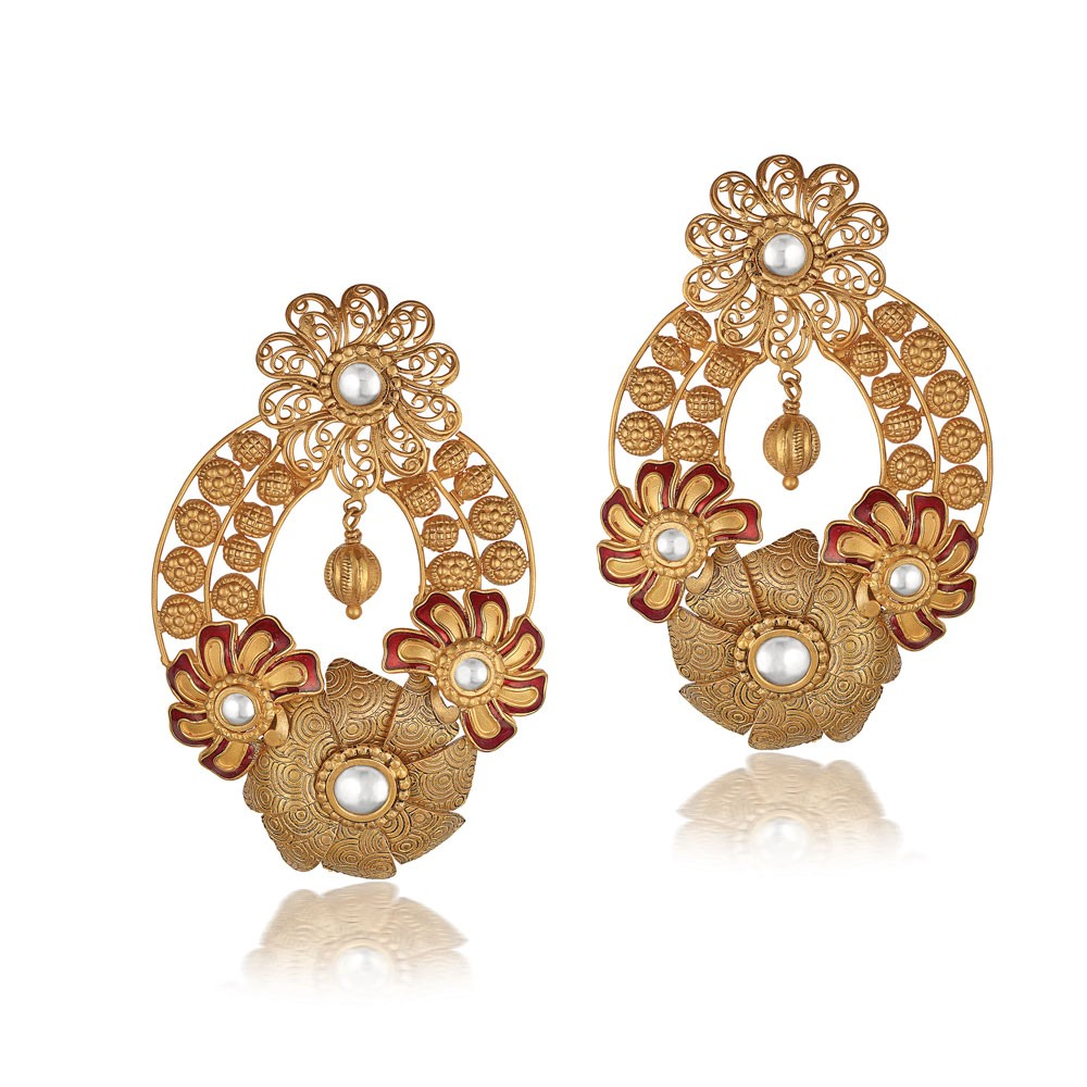 Add the dangle of the indian chandelier earrings or the jhumka add the dangle of the indian chandelier earrings or the jhumka designs in gold to your attire aloadofball Choice Image