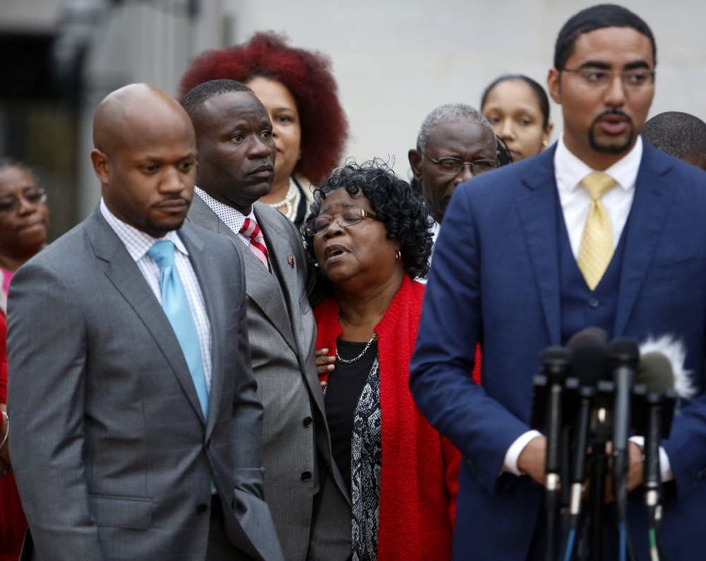 walter scott s family attorney speaks out on mistrial judy scott center walter scott s mother is comforted by her son rodney scott as the family attorneys chris stewart left and justin bamberg right