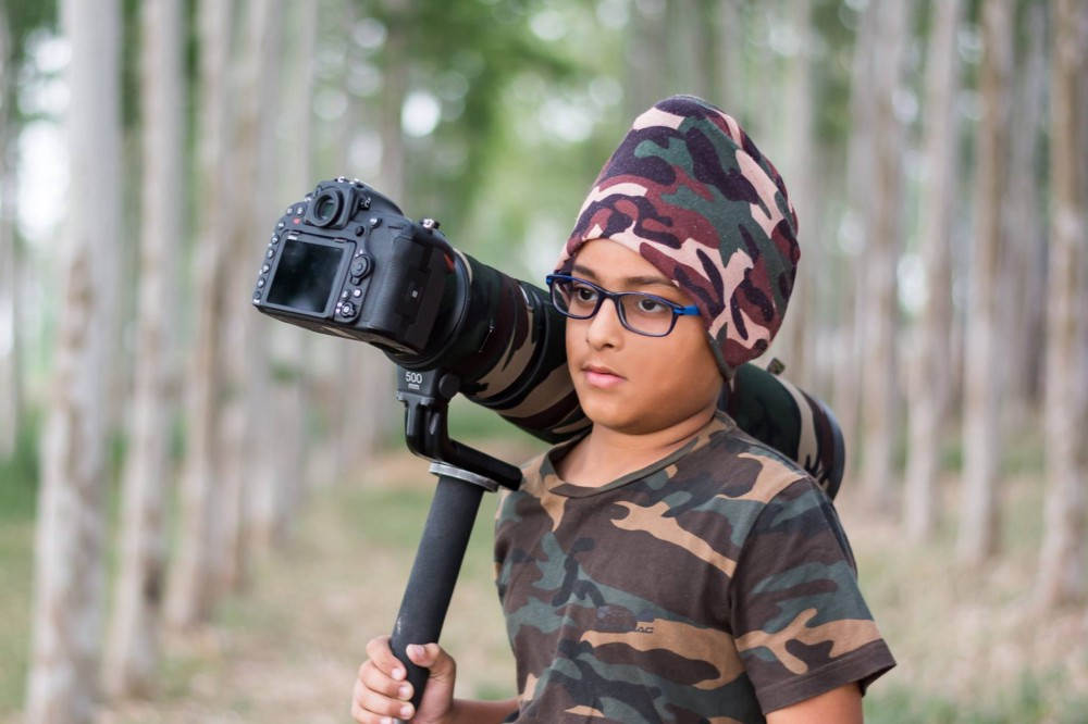 six-year-old Arshdeep holding a proffesional DSLR camera and is ready to shoot!