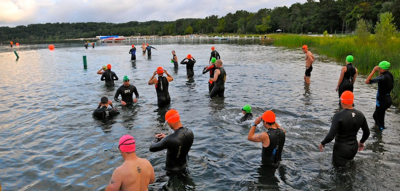 Swimmers enter the water at the beginning of the Traverse City Triathlon.