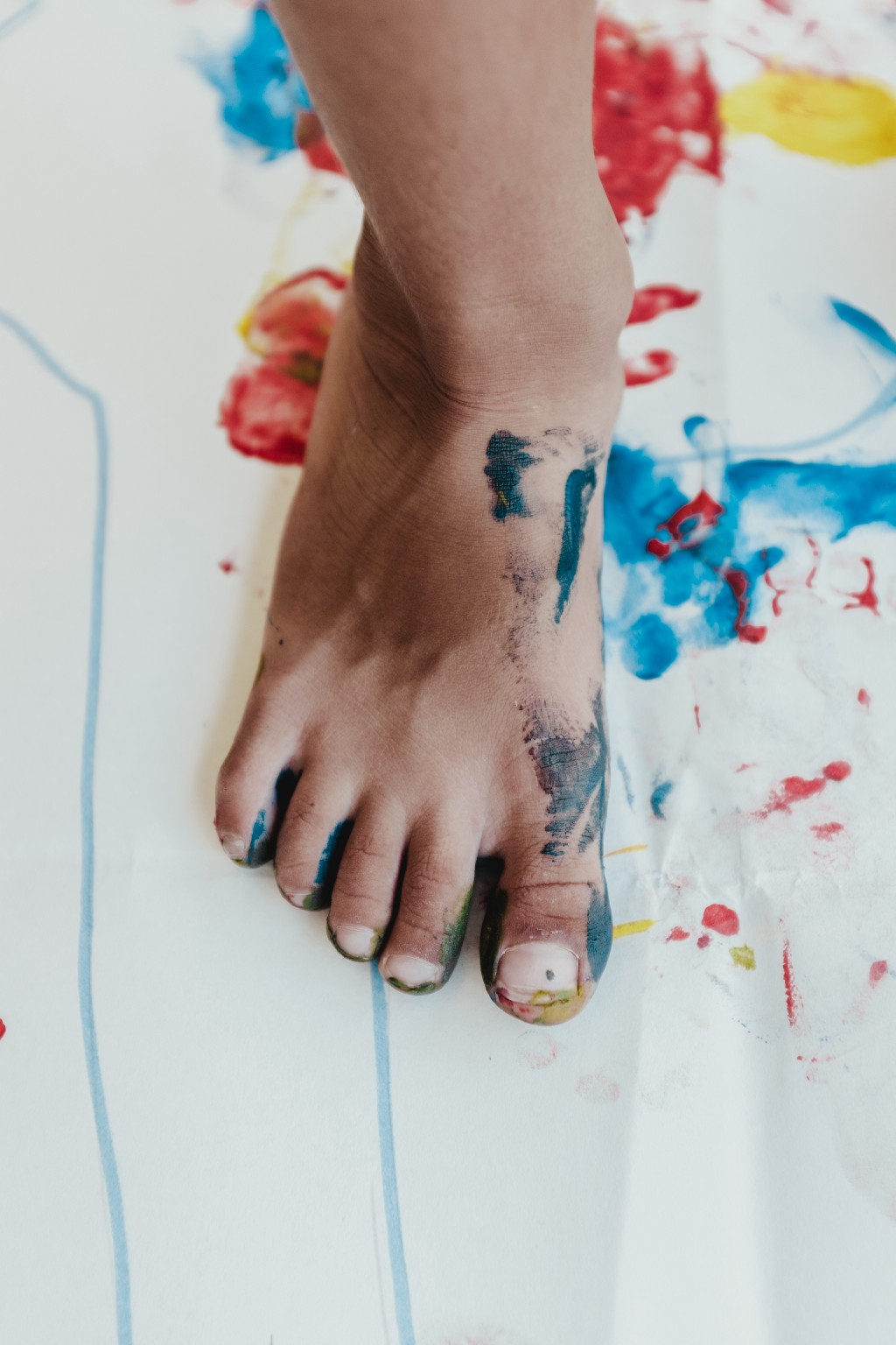 A foot splashed with paint.