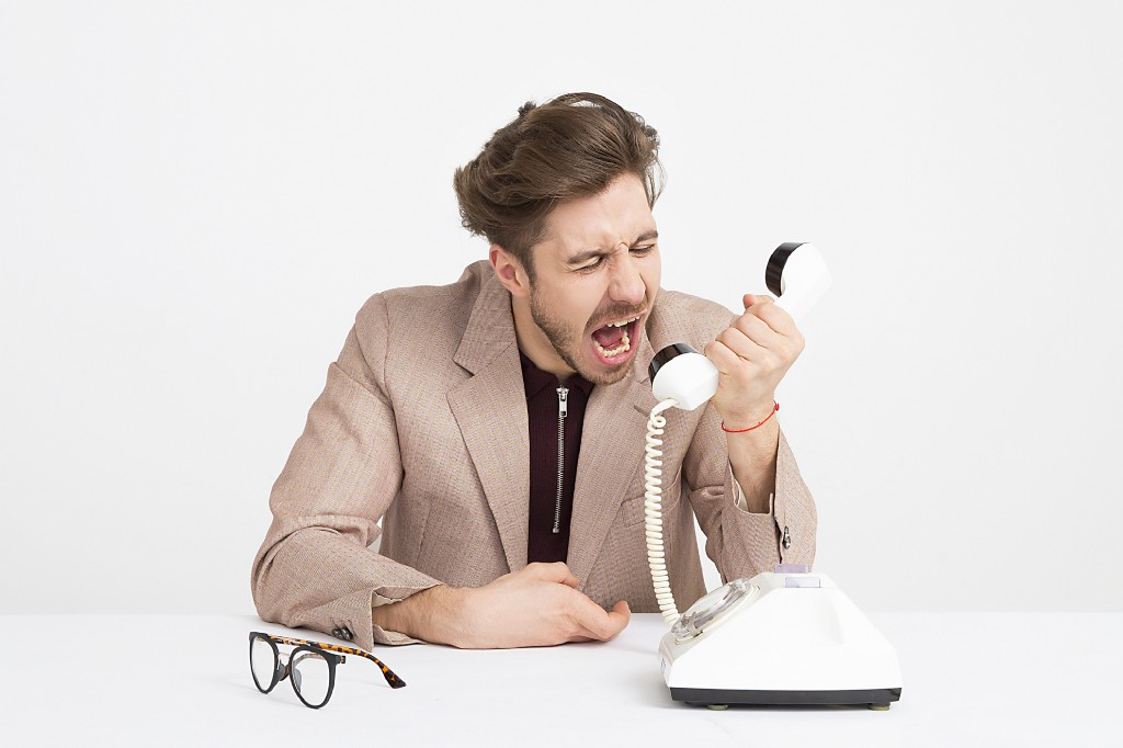 A man shouting on the phone