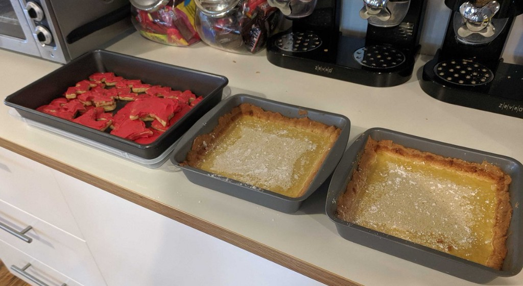 Three pans of baked goods arranged on a kitchen counter