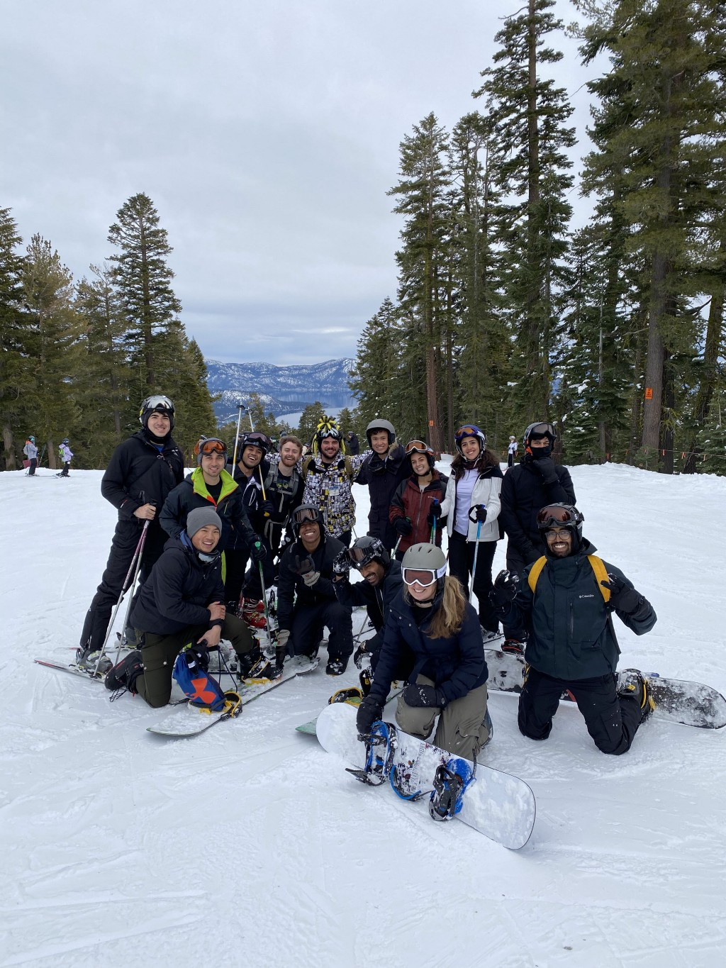 A group of adults in ski gear on a ski slope.