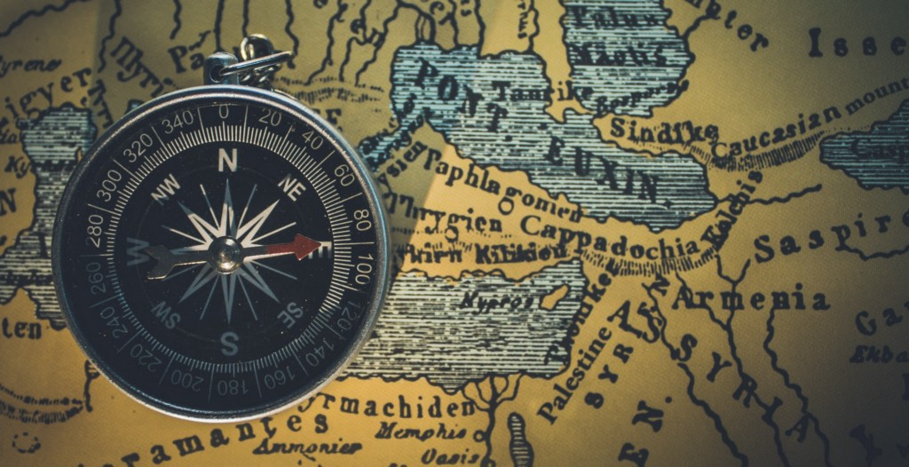 Top view of a compass on a map