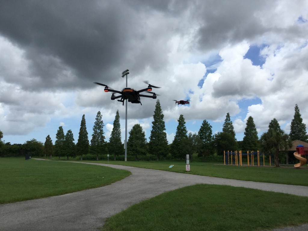 Drones flying over a park.