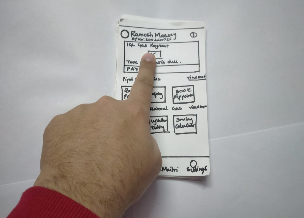 Image of a users hand interacting with Wizard of Oz prototype