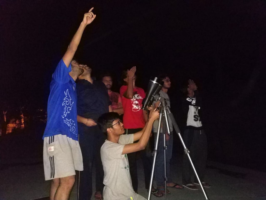 Group of youngsters looking at Planets through Binoculars