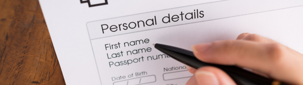 Person filling up personal details in an application form